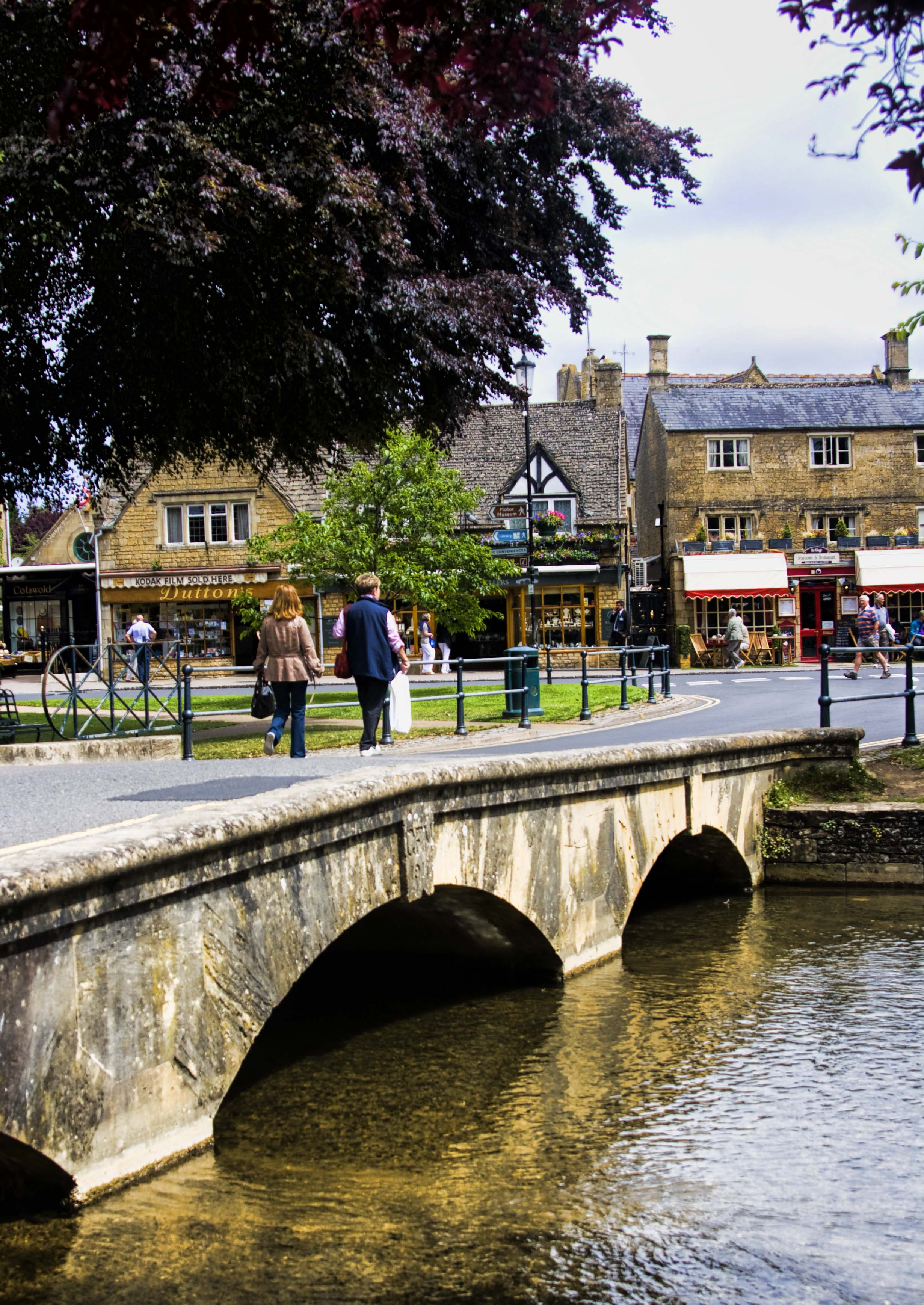 Stone bridge over the river with High Street in the back